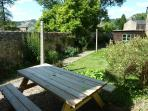 View of beautiful surrounding countryside from the top of sun-trap garden. Patio area with BBQ