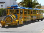 The tourist train runs around the streets of Albufeira