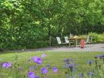 Enclosed outdoor seating area perfect for relaxing and taking in the wildlife