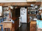 Farmhouse Kitchen is fully Equipped with antique butcher block table.
