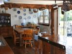 Another view of the open kitchen and dining area.