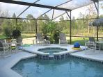 pool with spa and lake views