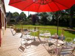 Spacious rear deck and garden, perfect for daytime sunbathing or eating out in the evening sunshine.