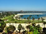 Mission Bay has grassy areas as well as sand.  There are playgrounds, bathrooms and wonderful paths.