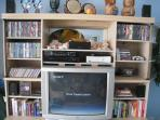 entertainmet center: cable TV, recently released  DVD's, surround sound, books, X-Box 360 & games