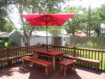 Custom maid picnic table provides shade while you bar-b-que and enjoy a beverage