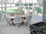 Sunroom dining for 6 and a foosball table!