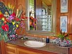 Your private bathroom adorned with fresh flowers from our property!