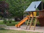 Playground next to outdoor pool will keep the little ones occupied for hours