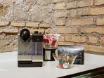 Nespresso coffe machine and comlimentary coffe pod.