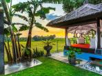 3 bedroom villa, sunset behind gazebo.
