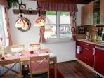 Fully equipped kitchen with microwave/oven, fridge, ceramic stove, toaster, kettle, coffee maker etc