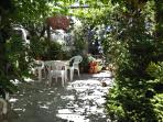 Vine and wisteria covered patio with table & chairs and gas barbecue.Special feature : tortoise garden.