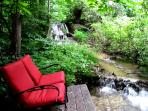 Bring your wine glasses down to the base of the waterfall and sit comfortably.