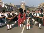 Listen to Massed Pipe Bands after the Highland Games in Dufftown or Aberlour or Tomintoul
