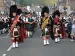 Massed Pipe Bands marching in Dufftown or Aberlour or Tomintoul