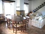 Large sitting/dining room - seats 8/single bed can be placed discreetly under stairs