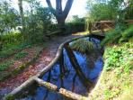 Vast grounds, paths + ornamental fish pond within Manor House walls - all yours !