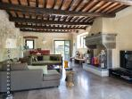 Master Sitting Room with satellite TV, smart TV, terrace, travertine tiles & original art