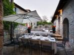 Courtyard at dusk, perfect for dining al fresco