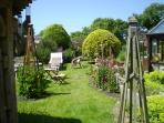 Another view of the peaceful garden for you to enjoy and relax. Maybe have a cool pre   dinner drink