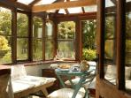 The sunny conservatory from kitchen door. Whatever the weather this is the place to enjoy the view.