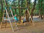 Childrens play area with swings, slides, playhouse, volleyball pitch and picnic tables