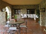 Porch with sitting and dining furniture