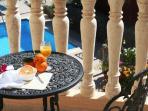 Breakfast on the balcony overlooking the pool and garden.