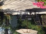 The sun terrace is bordered by rambling roses and honeysuckle. Aaaaaah..............