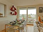 Open plan kitchen/dining/living with lake views