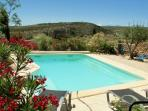 Private swimming pool with views of the chateau and the Pyrenees Mountains