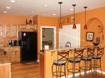 Kitchen with bar and additional dining seating