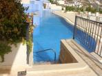Steps into the communal pool from your large private terrace