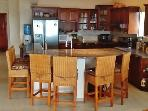 The cook/s can visit while preparing meals, thanks to the open floor plan and breakfast bar.
