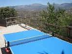 Exterior full sized table tennis.This area is fenced in with metal mesh and wood.