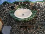 Bathroom sink with parabolic faucet cave