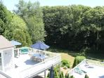 Huge deck and flat back yard with play set and lots of games