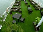 Public sundeck on the thirst floor, covered by artificial turf, bring an Eco feeling to tourist.