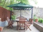 Lower garden area with barbecue, chiminea, large table and parasol