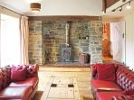 The fabulous inglenook with a cosy woodburner - logs are included