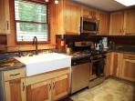Oversize Sink and Dishwasher. Fully Furnished Kitchen cookware, just bring your food!