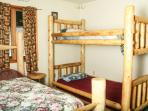 Bedroom 2 with full log bed and log bunk bed