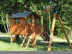 Shaded playhouse with activity centre