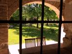 Casa La Vicinia, view from a window towards its private garden