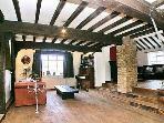 Split Level Sitting Room...beams, piano, oak floors