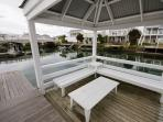 Gazebo on the water with floating jetty for boatmooring