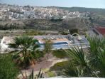 This is the view from the terrace, over the community garden and pool