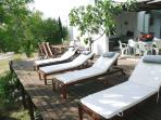comfortable wooden loungers in the outdoor deck lounge