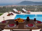 Outdoor dining table with stunning view to Lefkada and the pool